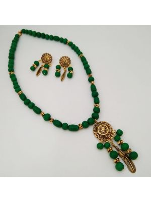 Necklace with green beads and golden pendant