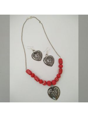 Necklace with red color beads and silver pendant
